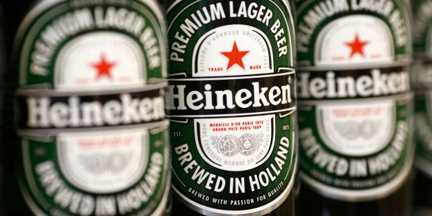 Bottles of Heineken lager, produced by Heineken NV, sit displayed for sale inside a supermarket in London, U.K., on Tuesday,