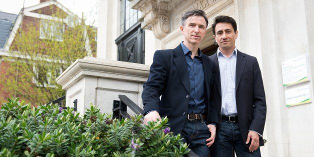 Peter McGraith (L) and David Cabreza pose for photographs at Islington Town Hall in north London on March 25, 2014.  The coup