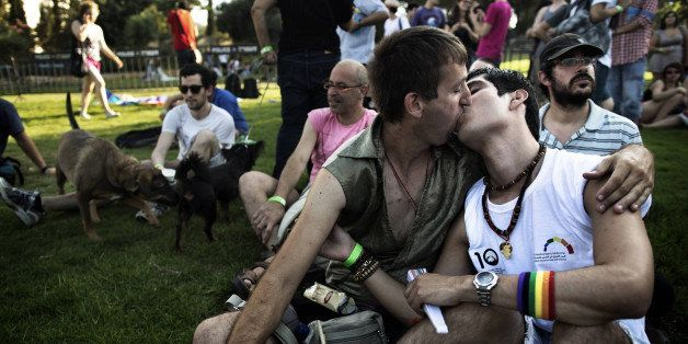 Two Israeli's kiss as they participate in the 10th anniversary Gay Pride Parade in Jerusalem on August 2, 2012. Opposition to