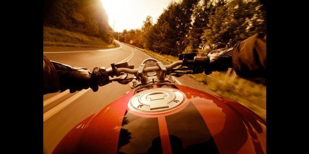 Riding motorcycle on country road in the sunset. Some lens flares. Shot wide angle with 5DII.