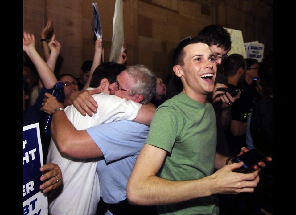 Supporters of same sex-marriage celebrate after Senate members voted and approved the same-sex marriage bill 33-29 during a s
