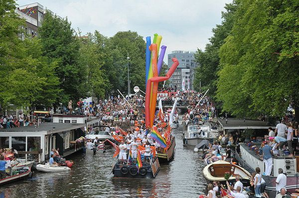 """The <a href=""""http://www.pilotguides.com/articles/float-your-boat-amsterdam-gay-pride/"""" target=""""_blank"""">Amsterdam Canal Parade"""