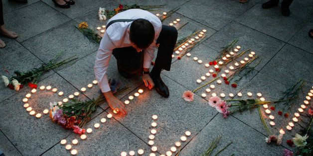 KUALA LUMPUR, MALAYSIA - JULY 21:  An Ukranian man lights up candles during a candle light vigil for the victims of MH17 on J