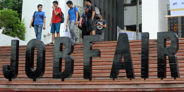 Job seekers attend a job fair at the College of Engineering at the University of the Philippines in Manila on January 16, 201