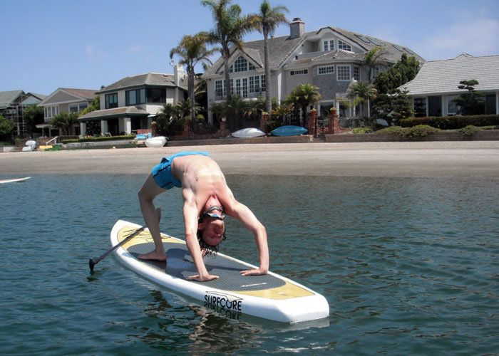 """<strong>10:45 AM: HUNTINGTON BEACH, CALIFORNIA</strong> Alexander Smith: """"Morning yoga on a stand up paddle board. I find bal"""
