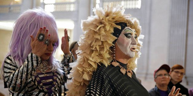 Drag queens Sister Roma, right, speaks as Heklina, left, adjusts her hair during a news conference about their battle with Fa