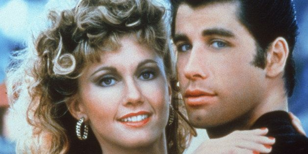 Actors John Travolta and Olivia Newton-John embrace in a promotional still for the film, 'Grease,' directed by Randal Kleiser