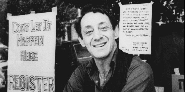 Harvey Milk poses in front of his camera shop in San Francisco in this Nov. 9, 1977 photo. Nov. 27, 1998 marks the 20th anniv