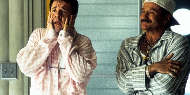 Nathan Lane and Robin Williams standing in pajamas on the porch in a scene from the film 'The Birdcage', 1996. (Photo by Unit