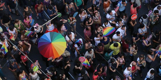 ISTANBUL, TURKEY - JUNE 29: People take part lesbian, gay, bisexual, and transgender (LGBT) Pride march on Istiklal Street in