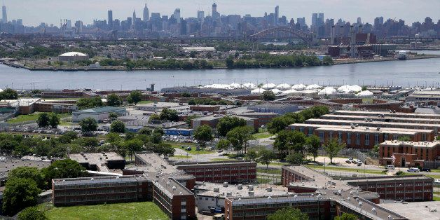 FILE- This June 20, 2014 file photo shows the Rikers Island jail with the New York skyline in the background. Over the past f