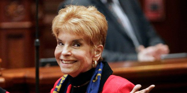 FILE - In this March 6, 2013 file photo, Illinois Comptroller Judy Baar Topinka gestures on the House floor at the state Capi