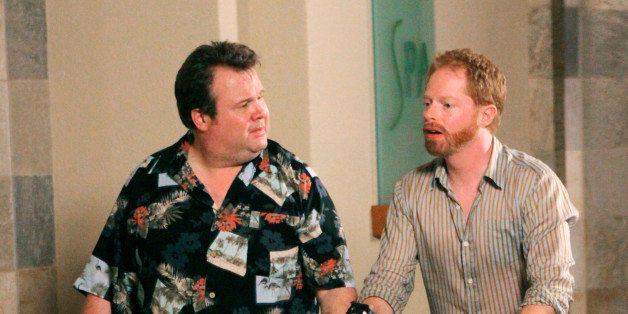 "In this publicity image released by ABC, Eric Stonestreet, left and Jesse Tyler Ferguson are shown in a scene from ""Modern Fa"