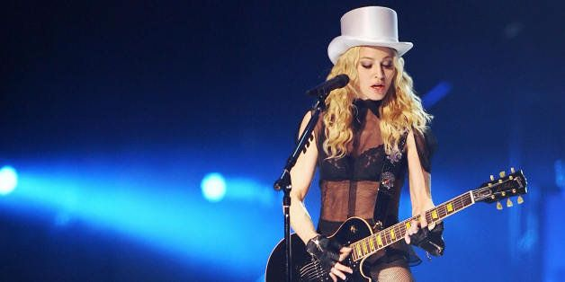 American singer Madonna performs onstage at the Cardiff Millennium Stadium on August 23, 2008 during the first concert of her