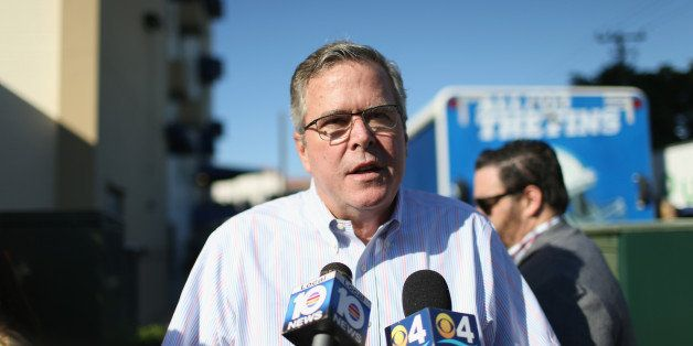 MIAMI, FL - DECEMBER 17:  Former Florida Governor Jeb Bush speaks to the media as he hands out items for Holiday Food Baskets