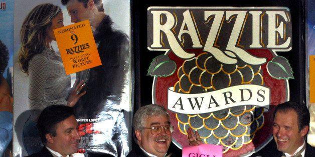 John Wilson, center, announces with Glenn Simon, left, and Bill Jones, right, the 24th Annual Golden Raspberry Award for 2003
