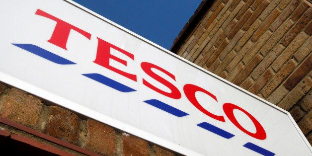 The sign outside a Tesco shop is seen in London, Tuesday, April 21, 2009. Tesco PLC, Britain's largest retailer has reported