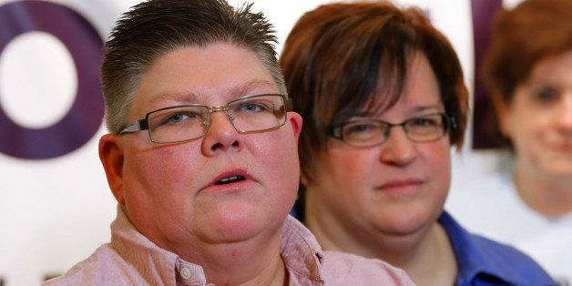 Jayne Rowse, left, and partner April DeBoer of Hazel Park, Mich., look on during a news conference in Ferndale, Mich., Friday