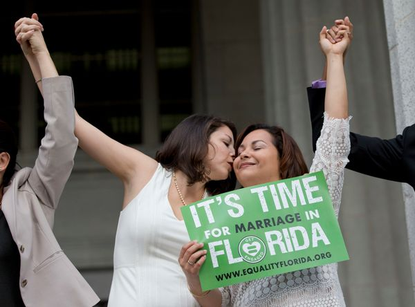Catherina Pareto (L) and her partner Karla Arguello celebrate on the court house steps after Circuit Court Judge Sarah Zabel