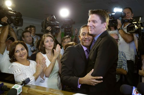Todd Delmay, right, and his spouse Jeff Delmay hug after they were married by Miami-Dade Circuit Judge Sarah Zabel, Monday, J