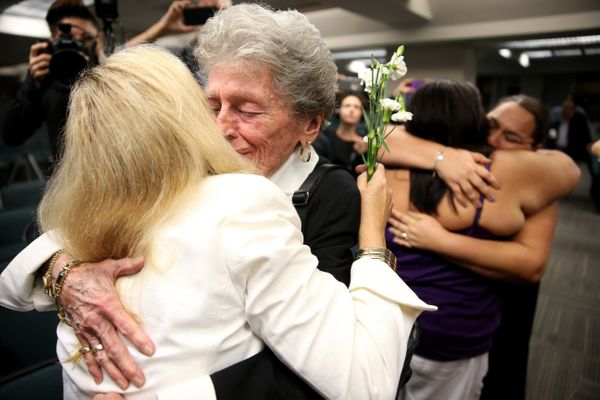 (L-R) Beverly Linn and Barbara Kelly embrace after getting married during a ceremony at the Broward County Courthouse on Janu