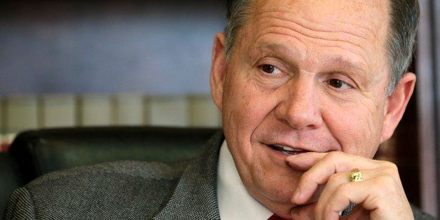 FILE -- In this Oct. 24, 2012 file photo, former Chief Justice Roy Moore poses for a photo in his Montgomery, Ala., office. T