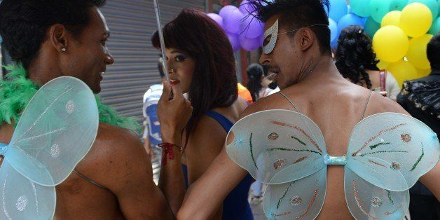 Participants march during Nepal's Gay Pride parade in Kathmandu on August 11, 2014.  Scores of gays, lesbians, transvestites