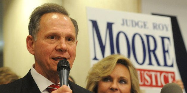Roy Moore, candidate for Alabama Supreme Court chief justice, speaks to the audience  as wife Kayla looks on at his election
