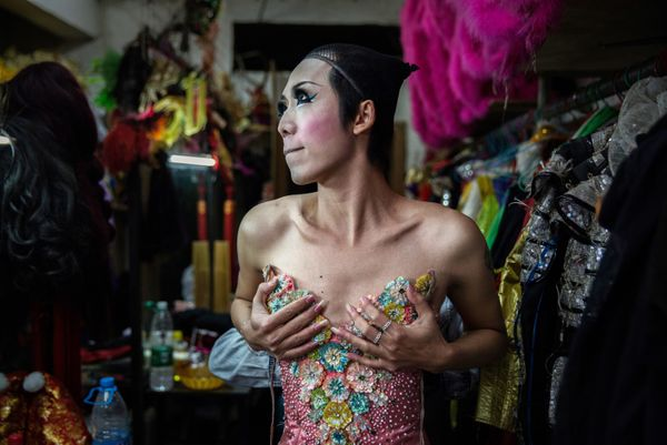 Chinese drag queen Caomei adjusts her bra backstage before performing at the Chunai 98 club on January 9, 2015 in Nanning, Gu
