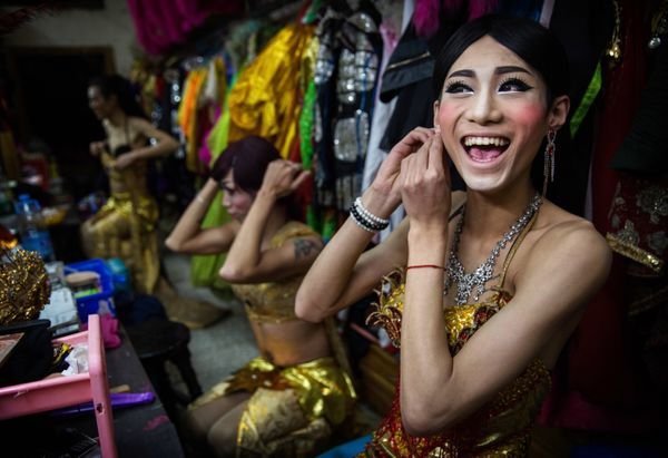 Chinese drag queen Baomei laughs while getting ready before performing at the Chunai 98 club on January 10, 2015 in Nanning,