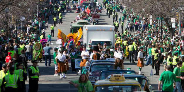 Crowds line the street during the annual St. Patrick's Day Parade in Boston, Sunday, March 18, 2012. (AP Photo/Michael Dwyer)