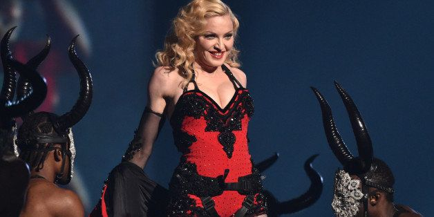 FILE - This Feb. 8, 2015 file photo shows Madonna performing at the 57th annual Grammy Awards in Los Angeles. Madonna, Rihann
