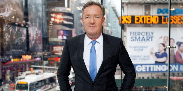 NEW YORK, NY - DECEMBER 08:  Piers Morgan visits 'Extra' at their New York studios at H&M in Times Square on December 8, 2014