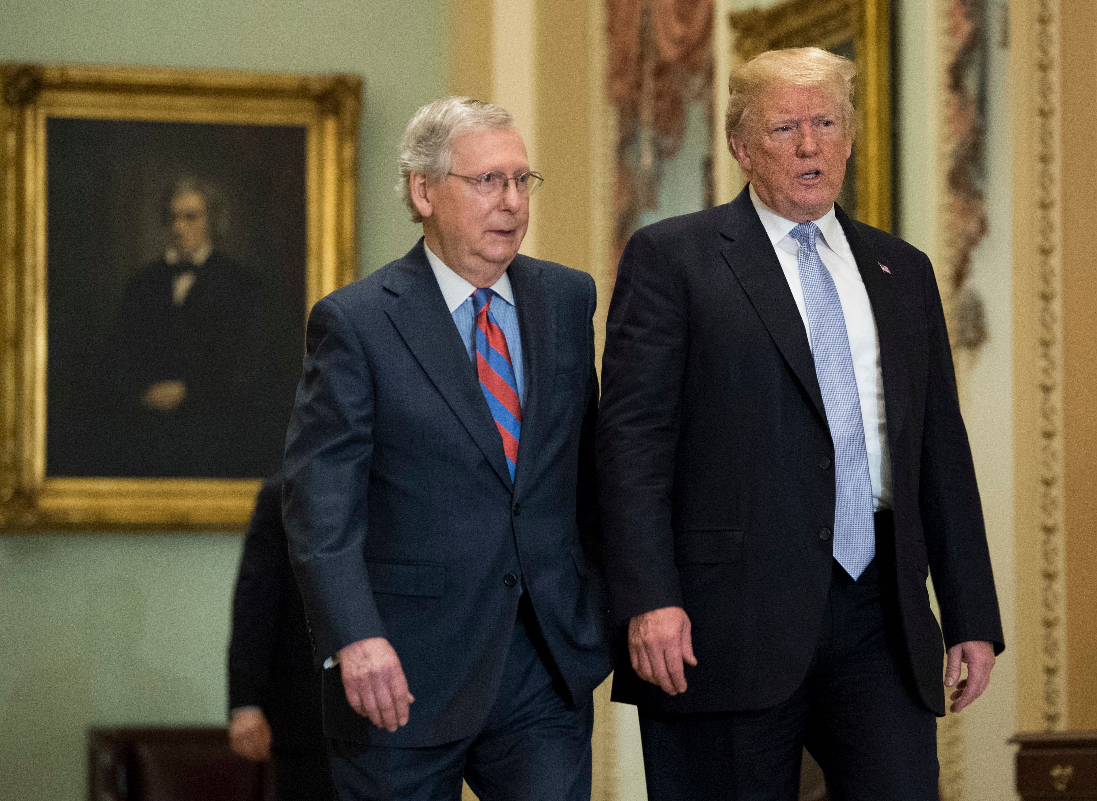 WASHINGTON, DC - MAY 15: US President Donald Trump (R) walks with Senate Majority Leader Mitch McConnell (R-KY) as he attends the Republican luncheon at the U.S. Capitol Building on May 15, 2018 in Washington, D.C. (Photo by Kevin Dietsch-Pool/Getty Images)