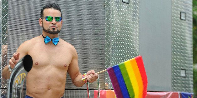 SAN JUAN, PUERTO RICO - JUNE 02:  A man dances during the anual gay pride parade on June 02, 2013 in San Juan, Puerto Rico. (