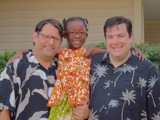 Christopher, left, and Richard, right, with Sophia on their wedding day last July.
