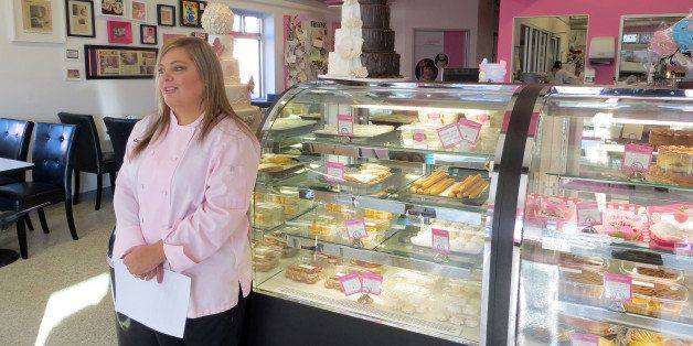 In this Jan. 20, 2015 photo, bakery owner Marjorie Silva stands for a photo inside her own Azucar Bakery, in Denver. Silva is