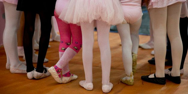 In this Aug. 8, 2014 photo, girls participate in a ballet class at the House of Dreams dance studio in Crackland, one of the