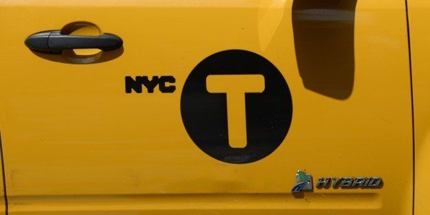 New York City Taxis  come down 2nd Avenue in New York  on July 10, 2014. The battle between ride-sharing and traditional taxi