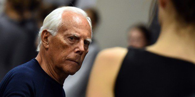 Italian designer Giorgio Armani works backstage before his show at the women Fall / Winter 2015/16 Milan's Fashion Week on Ma