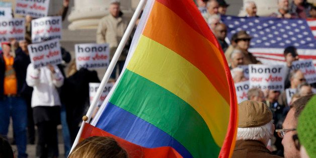 FILE -  In this Nov. 19, 2014, file photo, supporters of Arkansas' law banning same sex marriage, top, hold a rally as a prot