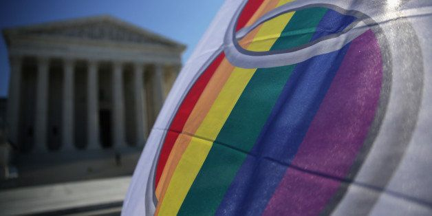 WASHINGTON, DC - JANUARY 09:  An activist flies a 'marriage pride flag' outside the U.S. Supreme Court January 9, 2015 in Was