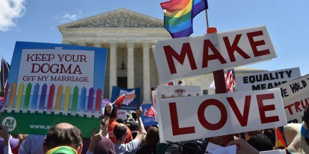 Supporters of same-sex marriages cheer outside the US Supreme Court on April 28, 2014 in Washington, DC. AFP PHOTO / MLADEN A