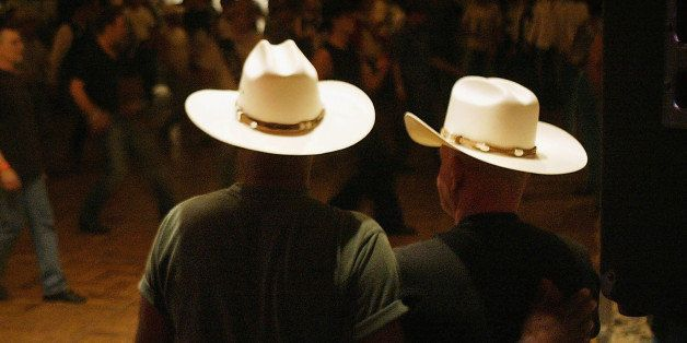 DEL MAR, CA - SEPTEMBER 17:  Cowboys dance with one another on the eve of the gay-oriented 16th Annual San Diego Rodeo on Sep