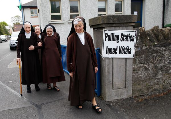 Carmelite sisters leave a polling station in Malahide, County Dublin, Ireland, Friday, May 22, 2015. Ireland began voting Fri