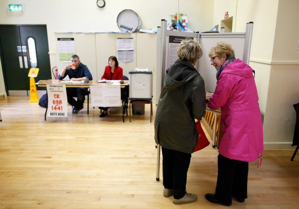 Women cast their vote in a polling station in Malahide, County Dublin, Ireland, Friday, May 22, 2015. Ireland began voting Fr