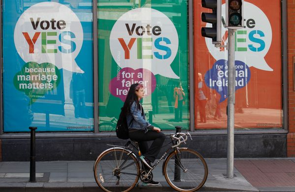 YES posters cover a shop's windows in the center of Dublin, Ireland, Thursday May 21, 2015. People from across the Republic o