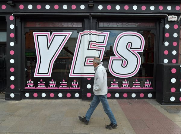 A man walks past a gay bar promoting the Yes campaign in favour of same-sex marriage on May 22, 2015 in Dublin, Ireland. Vote