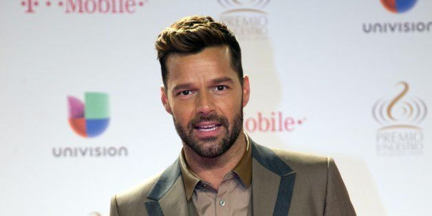 Puerto Rican singer Ricky Martin poses for photographers as he arrives at the Premio Lo Nuestro Latin Music Awards show, Thur