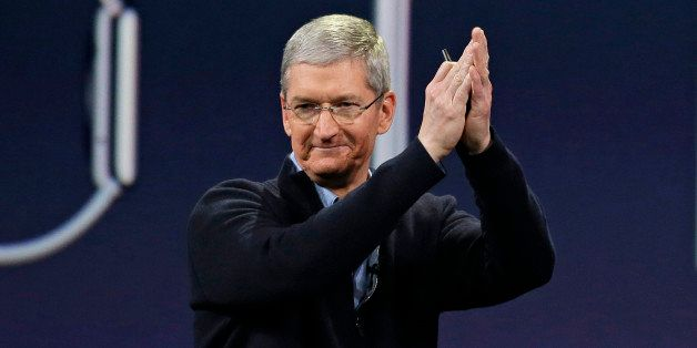 """In this Monday, March 9, 2015 photo, Apple CEO Tim Cook applauds at the conclusion of the Apple """"Spring Forward"""" launch event"""